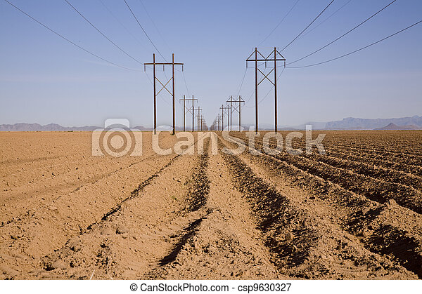 Plowed Field with High-Tension Line - csp9630327