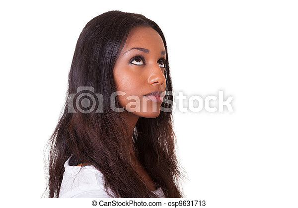 Young beautiful black woman looking up  - csp9631713