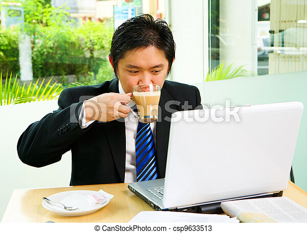 Drinking cofee while working in cafe