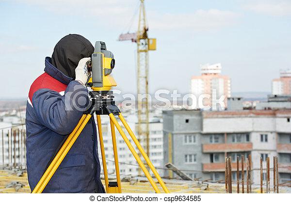 surveyor works with theodolite - csp9634585