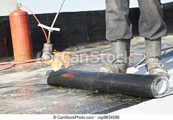 Flat roof covering works with roofing felt - csp9634586