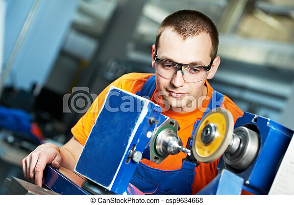 industrial worker at sharpening machine tool - csp9634668