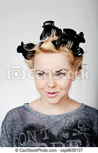 teen aged girl with rollers - csp9638107