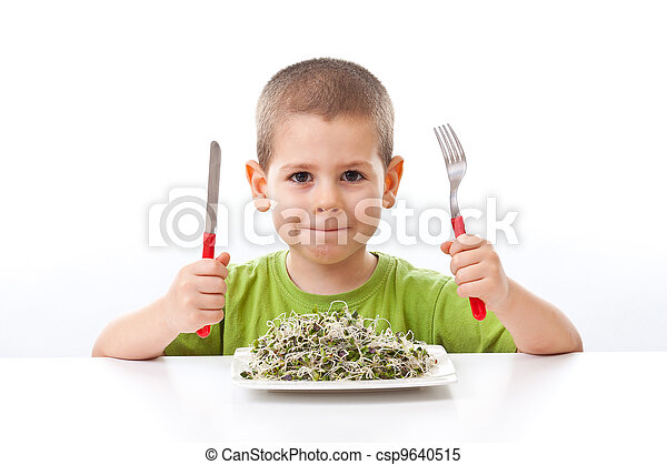 Kid taking green food - csp9640515