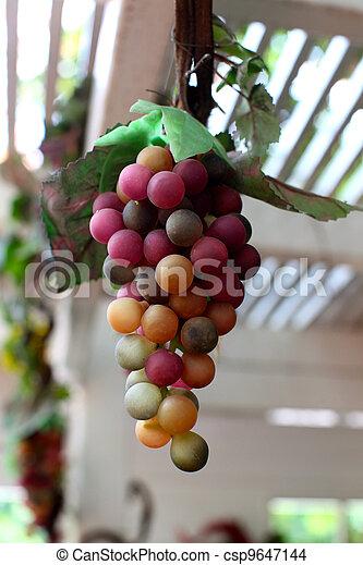fake bunch grape in garden - csp9647144