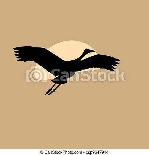 crane in sky on solar background - csp9647914