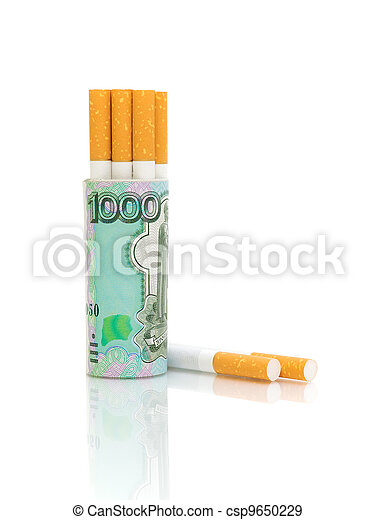 Cigarettes and banknotes on a white background - csp9650229