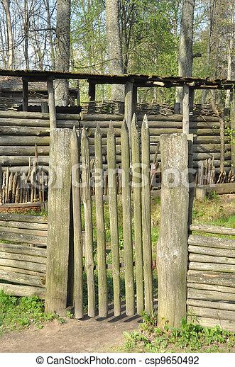 Photo de petit portail bois mur forteresse csp9650492 for Petit portail bois