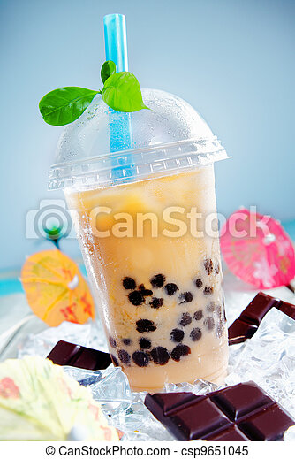 Iced drink with chocalate and a touch of green - csp9651045