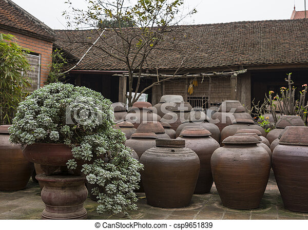 Farm courtyard with urns of fermenting soy sauce. - csp9651839