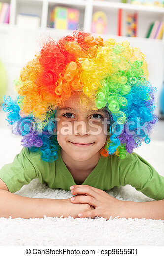 Young boy with clown wig - csp9655601