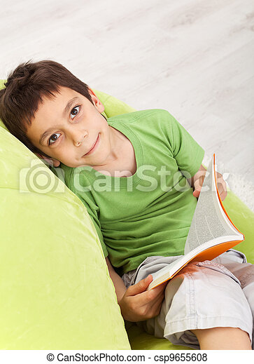 Young boy reads a book - csp9655608