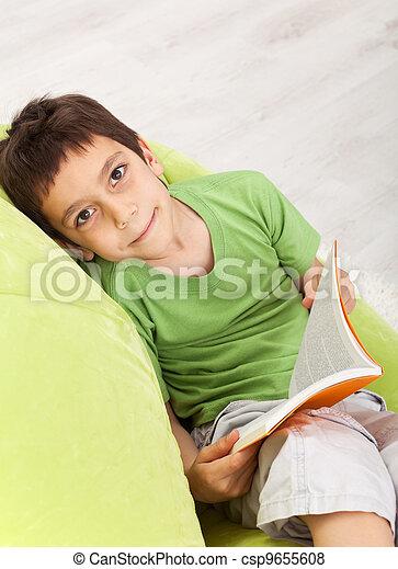 Young boy reads a book - csp9655608