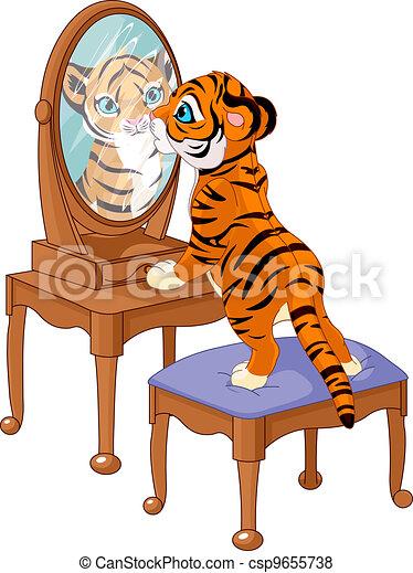 Tiger cub looking in the mirror - csp9655738