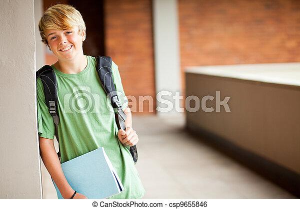cute high school boy portrait in school - csp9655846