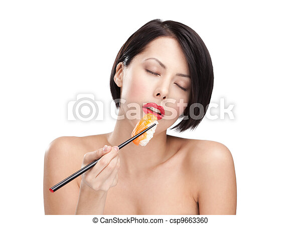 Young attractive woman holding sushi, eyes closed - csp9663360