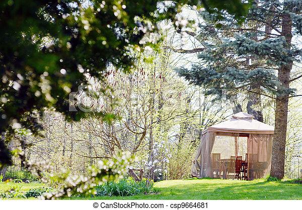 Bower arbour summerhouse furniture. Rest in garden  - csp9664681