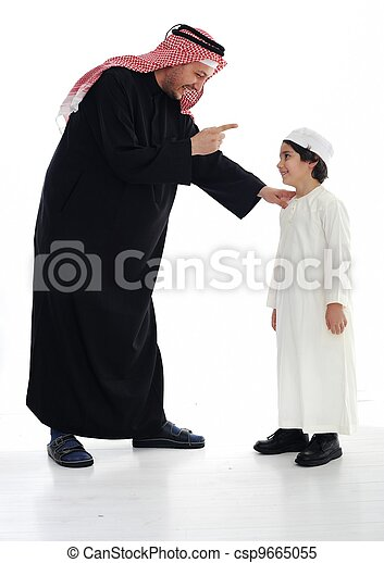 Arabic Muslim father and son standing together - csp9665055