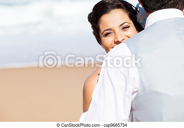 happy young woman hugging husband  - csp9665734