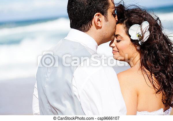 loving groom kissing bride's forehead  - csp9666107
