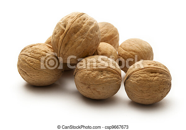 Heap of walnuts on white - csp9667673
