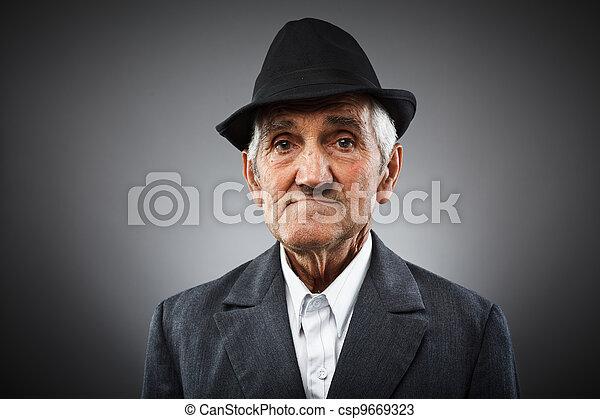 Expressive senior portrait - csp9669323