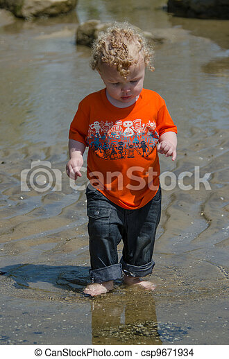 Soaked Boy At The Beach - csp9671934