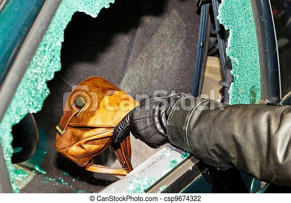 a thief stole a purse from car - csp9674322