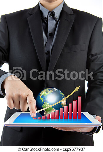 Business man holding the modern digital tablet pc with success growth chart and earth - csp9677987