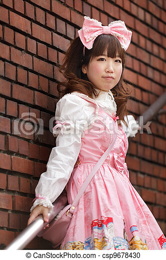 japanese lolita cosplay posing on stairs