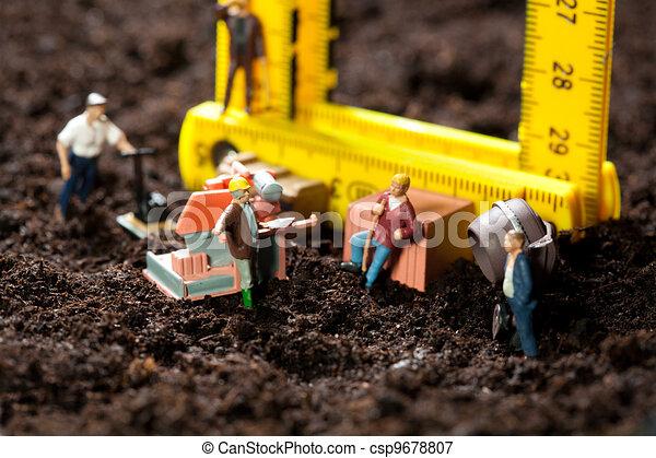 Miniature workmen building a house - csp9678807