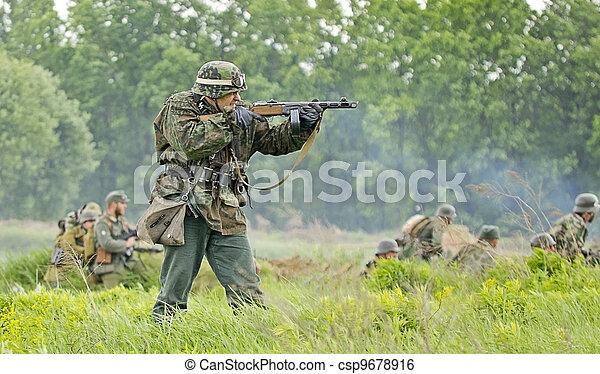 KIEV, UKRAINE - MAY 13 : members of Red Star history club wear historical military German uniform during historical reenactment of 1945 WWII, May 13, 2012 in Kiev, Ukraine - csp9678916