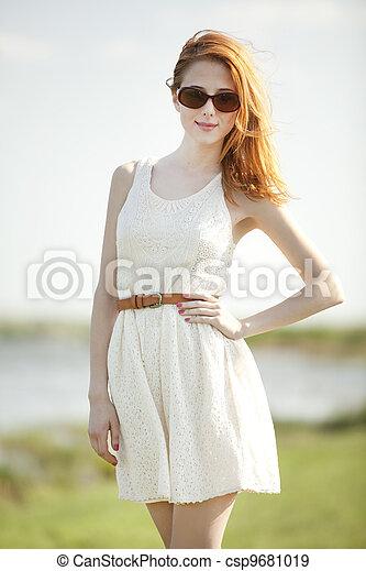 Fashion redhead girl at outdoor. - csp9681019
