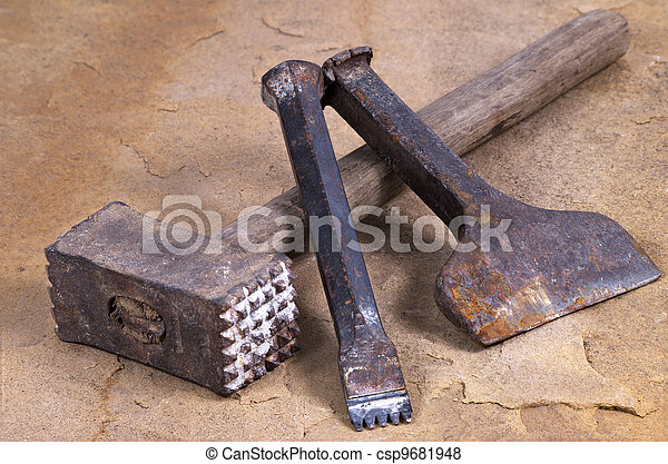 a hammer with two chisels - csp9681948