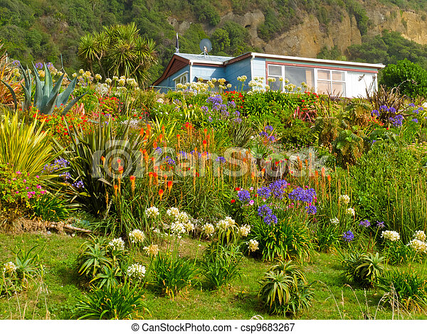 Rural dream house in lush flowering natural garden - csp9683267