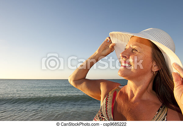 Portrait mature woman sunset ocean - csp9685222