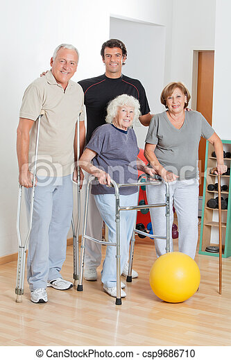 Portrait Of Disabled Senior People With Trainer - csp9686710