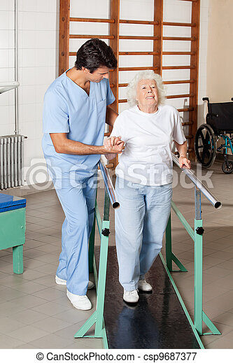 Therapist Assisting Tired Senior Woman On Walking Track - csp9687377
