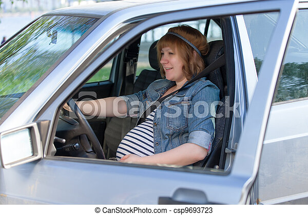 Pregnant woman in driving seat of the car - csp9693723