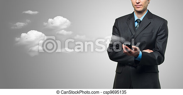 Businessman with touch screen phone and the clouds - csp9695135