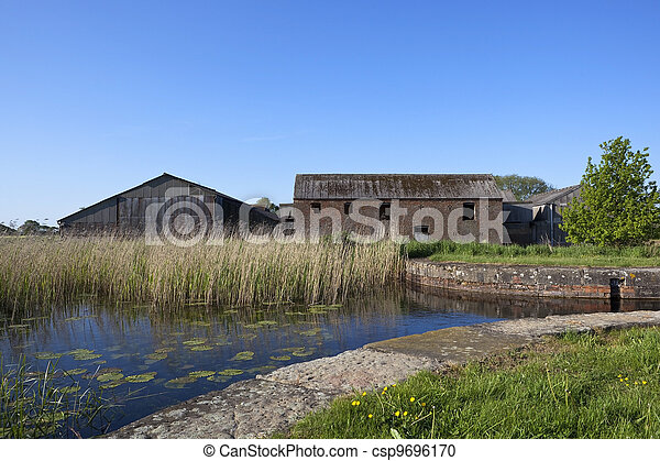 derelict canal with barns - csp9696170