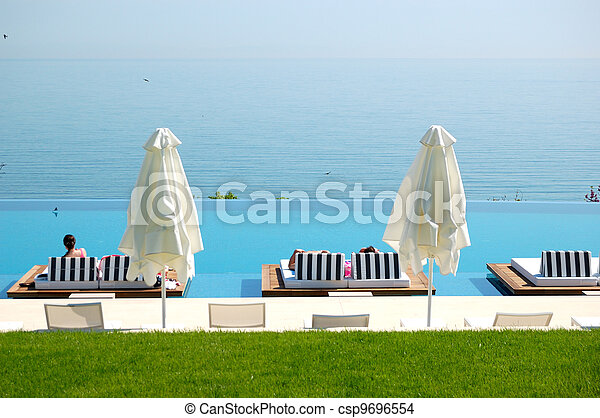 Infinity swimming pool by beach at the modern luxury hotel, Pieria, Greece - csp9696554