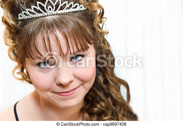 Beauty young Caucasian woman with curly hair and crown on nead - csp9697438