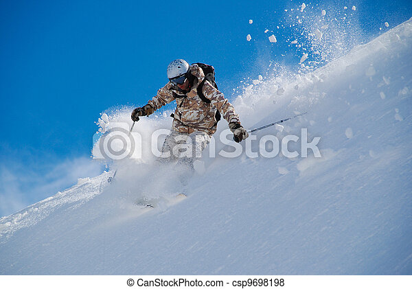 Skier in bright clothing, in deep snow - csp9698198