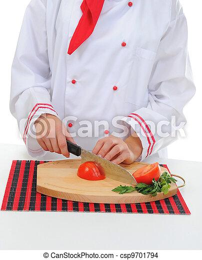 Chef cuts the tomato - csp9701794