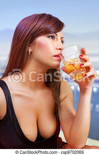 brunette woman with glass of whisky - csp9702069