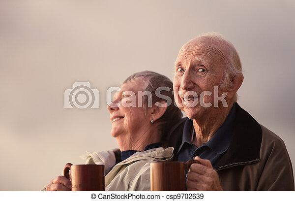 Happy Senior Citizen Couple Outside - csp9702639