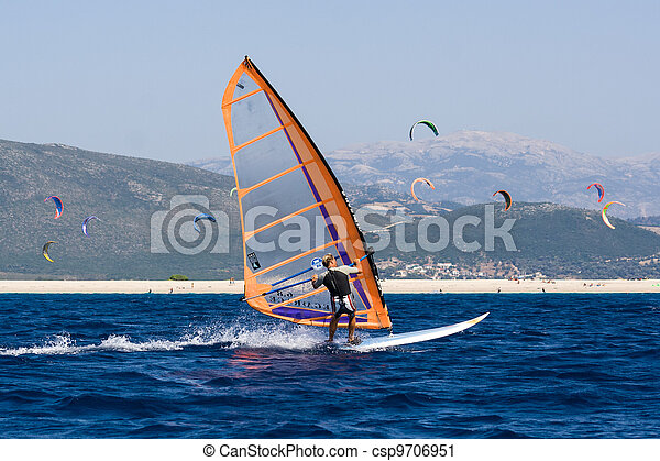 Windsurfing along the coast in the middle of the kite - csp9706951