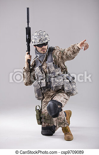 Armed Soldier pointing with finger - csp9709089
