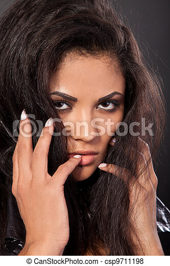 Portrait of attractive mixed race woman with hand on chin - csp9711198